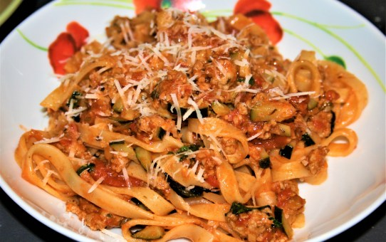 Tagliatelle with sausage ragu, courgette and hazelnuts