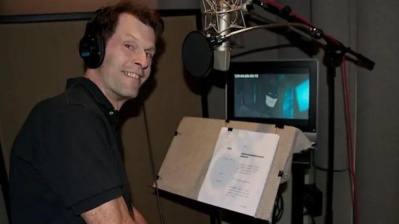 Kevin Conroy in the studio voicing Batman