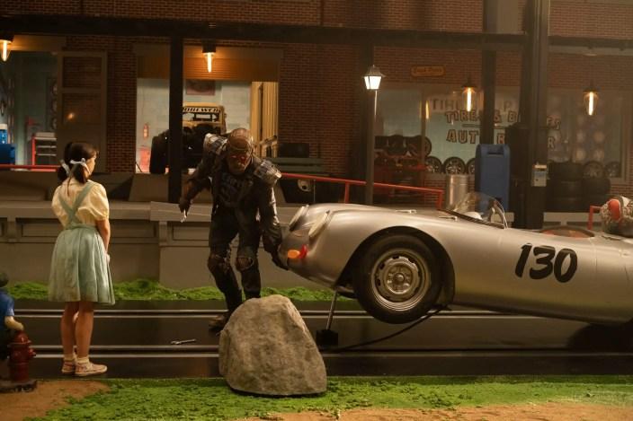 Doom Patrol Season 2 E1 - Robotman picking up a car in front of Dorothy