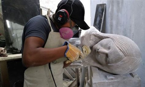 Millard working on one of his sculptures.