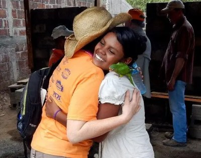 Tamara Danel (left) says goodbye to a new friend in Nicaragua