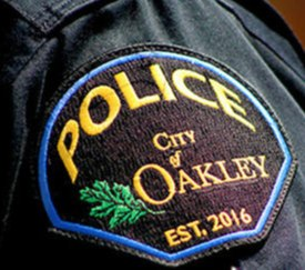 Brown shoulder patch, police, city of Oakley, est. 2016 in gold letters, green oak leaf sewn into patch