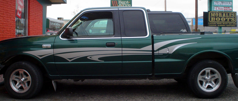 Mazda pickup with silver accent stripe graphics