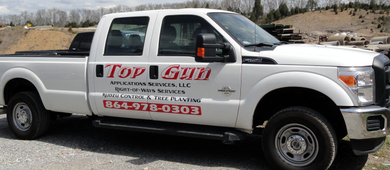 Red and black advertising decals on the side of a Ford diesel pickup