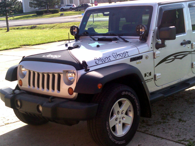 Silver Jeep Wrangler with black lettering decals and graphics