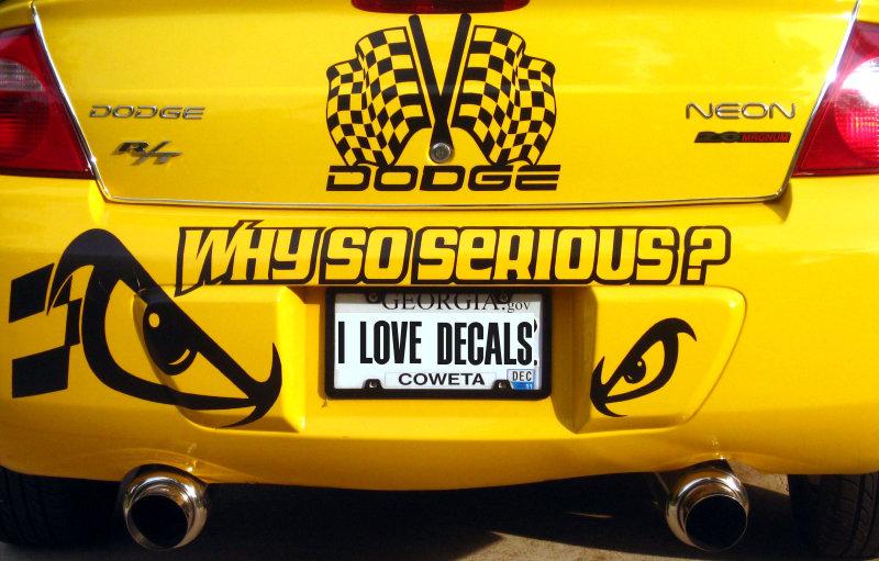 Yellow Dodge Neon with black vinyl graphics