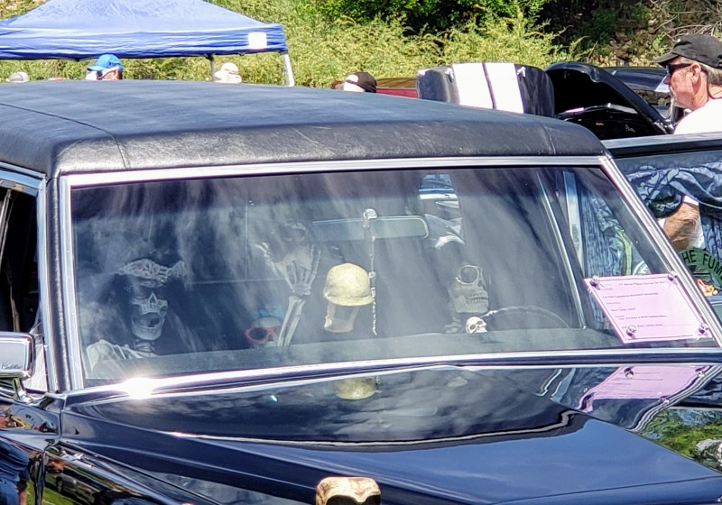 Close-up of Spooky Halloween Hearse with skeletons inside