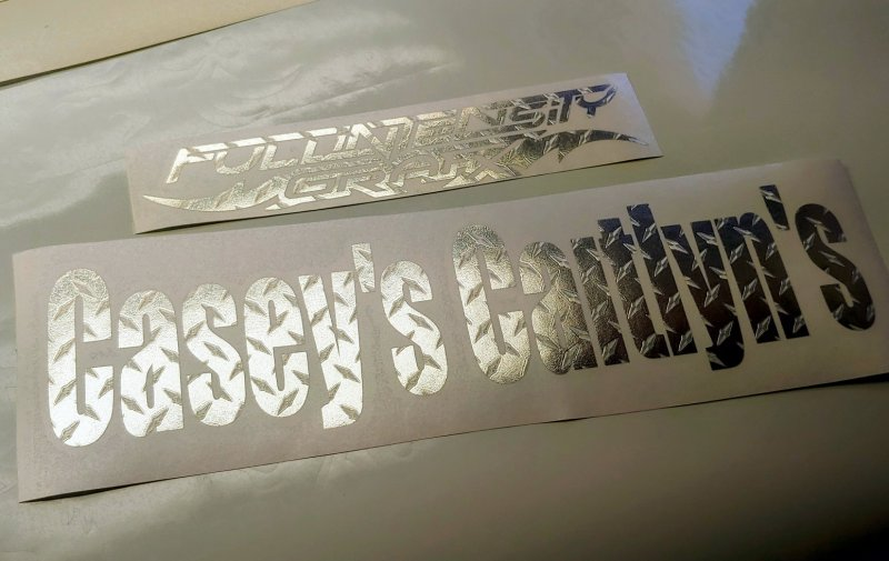 custom lettering decal in diamond-plate silver with bold text