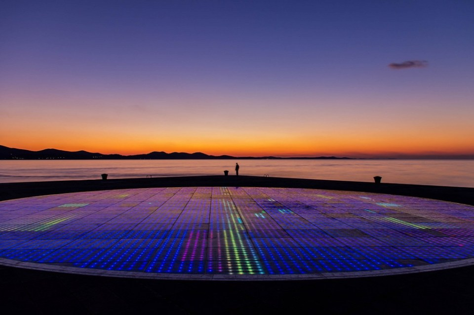 "Zadar's amazing ""Greetings to the Sun"" installation at sunset, by Jason Drury. At the front is the ""sea organ,"" which plays music as waves wash in."