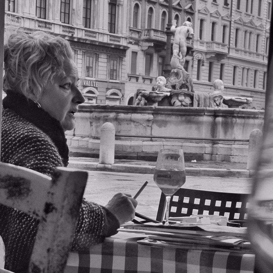 This was the kind of woman with hand gestures and mannerisms that made me think I'd avoid her at parties, but gosh, she makes an awesome subject. Trieste, Italy.