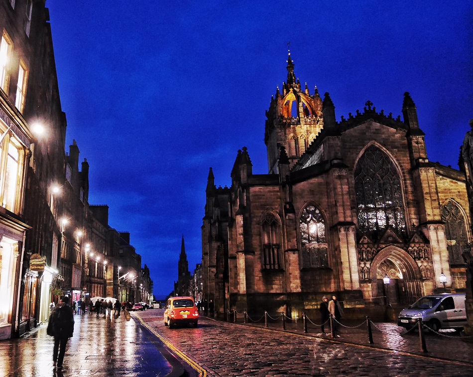 I shot this while I listened to the bagpiper breaking my heart on the Royal Mile. It's Giles Cathedral at dusk.