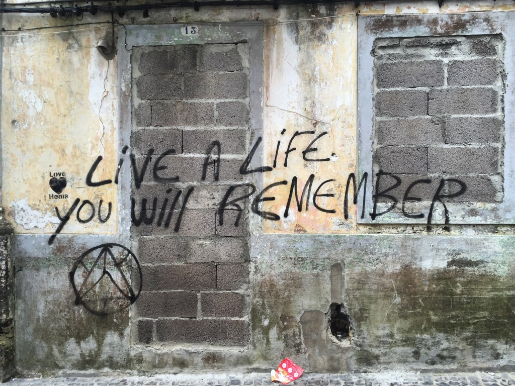 """Walking in the Azores, I pondered how amazing my life was some days, then I came across this graffiti and thought, """"That's what I'm doing."""" And yeah, I'm having some second thoughts about the ways I travelled, but I also know I'll never forget it."""