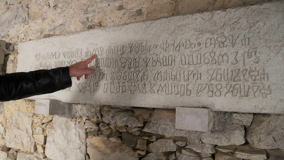 My friend Alen points at Glagolitic script in the smallest town in the world, Hum. This is an ancient writing used only in Great Moravia, Bulgaria, and last kept alive by the Croats.