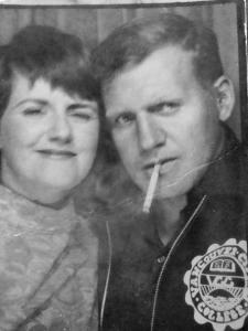 My parents at the start of their marriage, my dad a bad-ass. They didn't smoke when we were growing up, but it sure added to the mystique in their youth.
