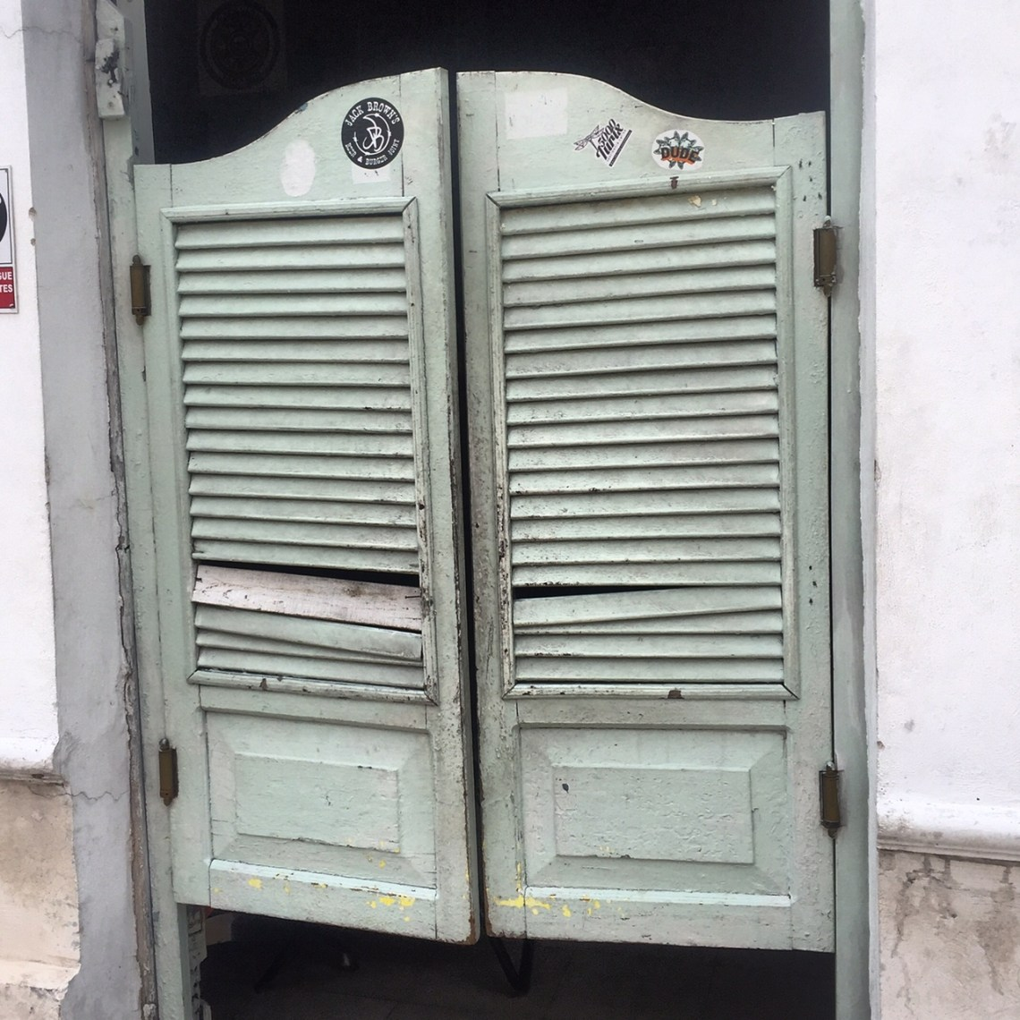 These battered doors have swung open for tequila-swilling masses for nearly 100 years. Merida, Mexico. La Negrita Cantina.