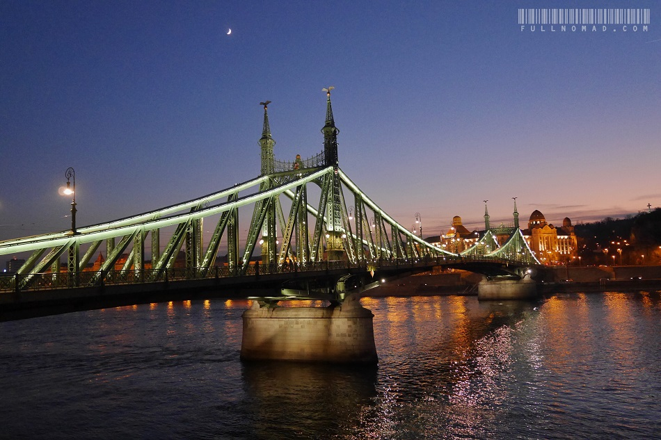 Szabadag Bridge in crosses the Danube River, shown at sunset in December. Its English name is Liberty Bridge.