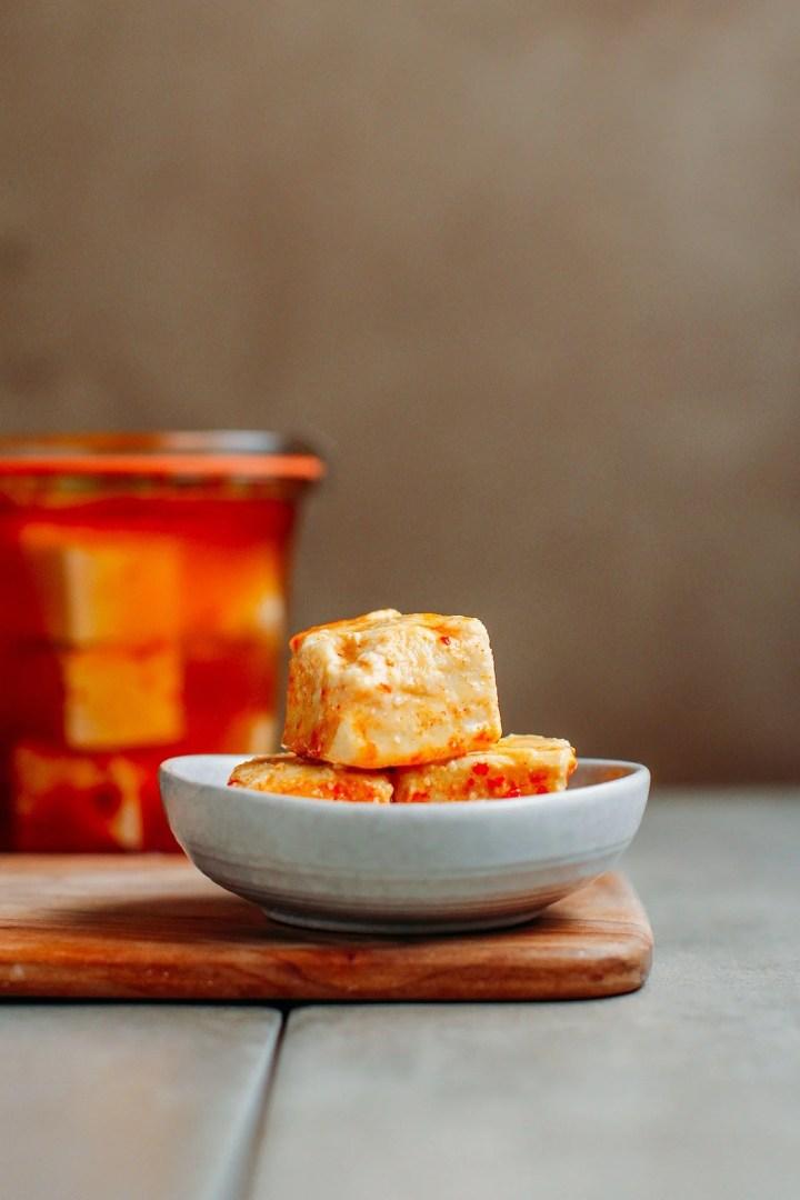 Fermented tofu cubes in a bowl.