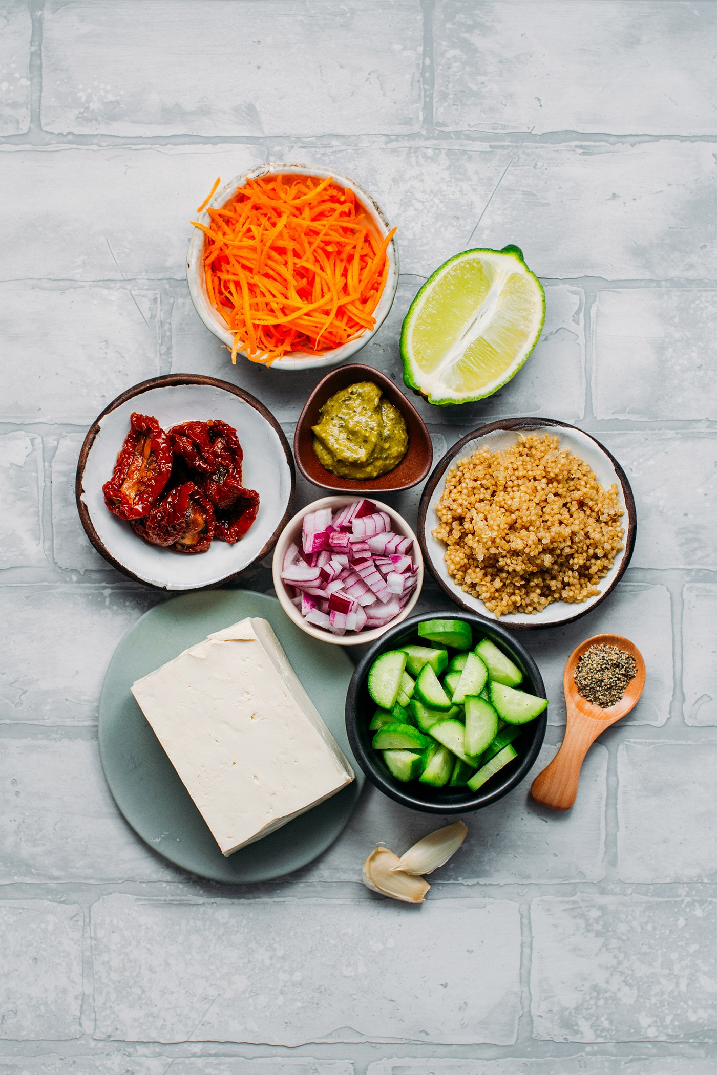 Ingredients to make a quinoa pesto salad with baked tofu.