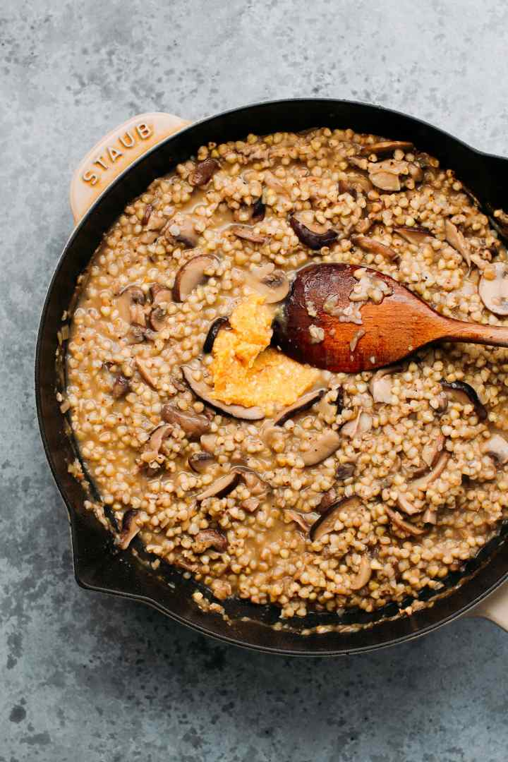 Buckwheat risotto in a skillet.
