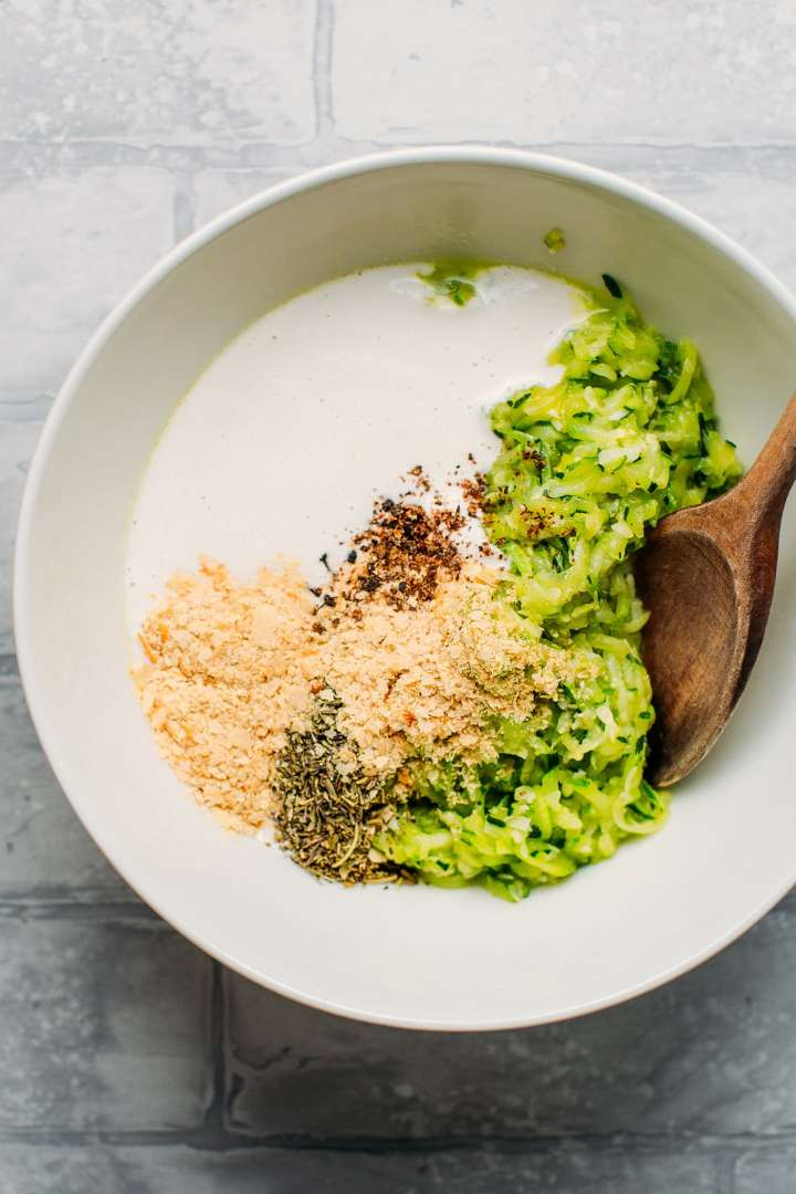 Zucchini, nutritional yeast, and cashew cream in a bowl.