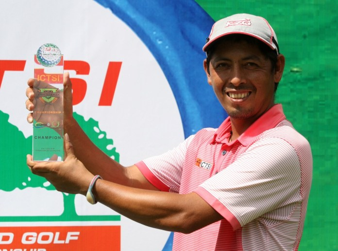 Rufino Bayron holds his trophy after finally scoring a breakthrough win at ICTSI Orchard Golf Championship.