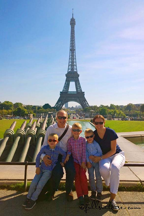Family with three young kids traveling in Paris