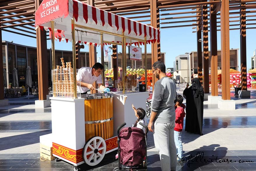 Arabic family at a Turkish ice cream stand on The Walk in Dubai