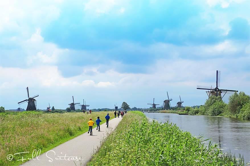 Kids exploring Kinderdijk by kick scooters