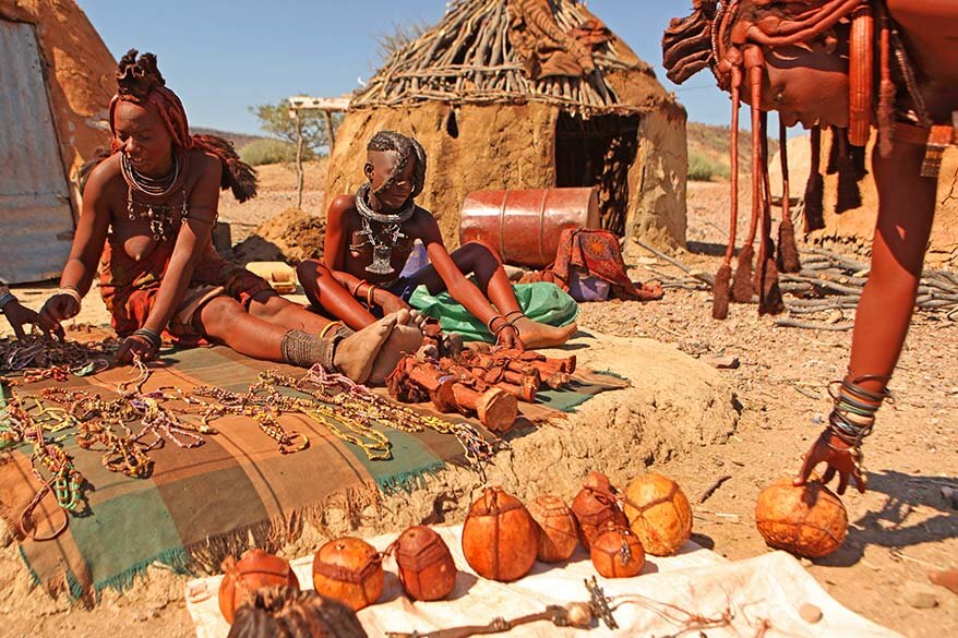 Himba women in Namibia selling traditional hand-made souvenirs