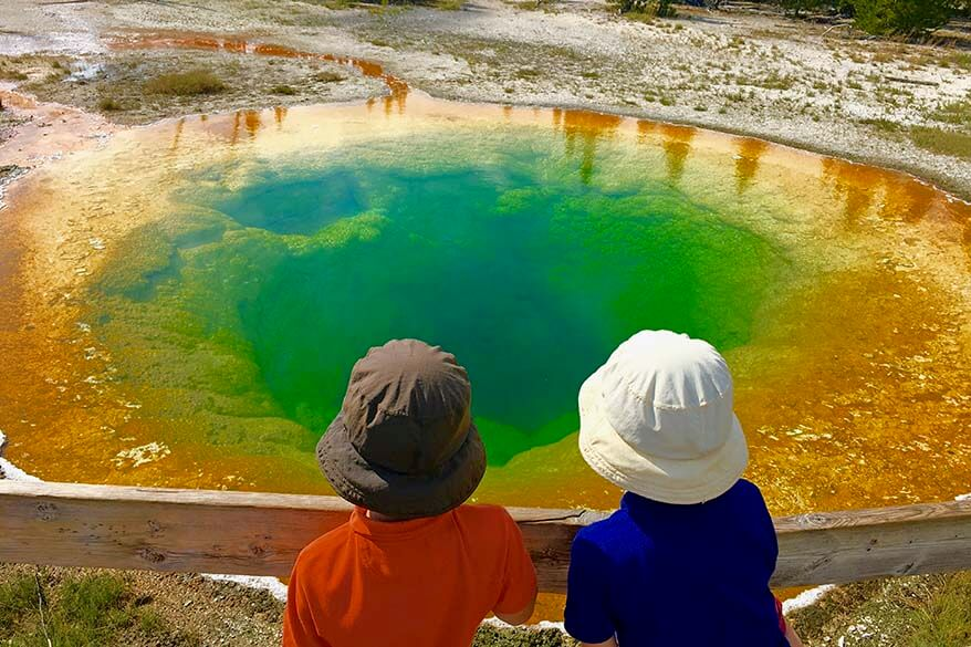 Kids at the Morning Glory Pool in Yellowstone