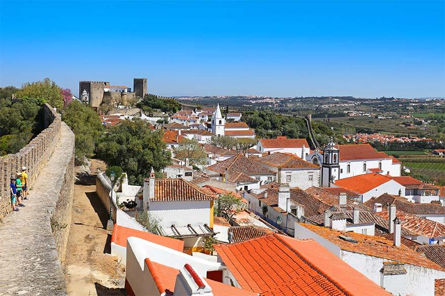 Kids walking on the city walls of Obidos in Portugal