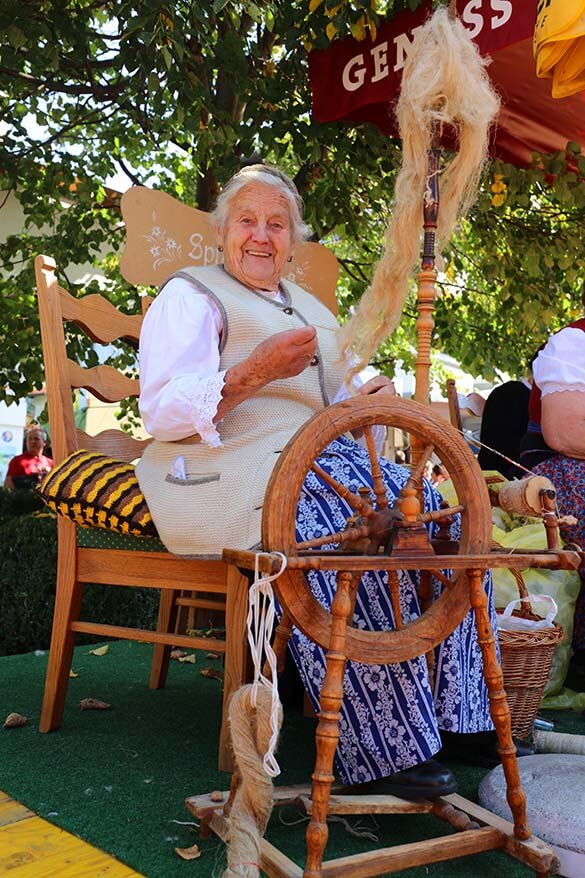Local women demonstrating traditional handcrafts at the farmers market in Tirol Austria