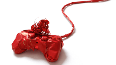 Playstation controller in red wrapping paper.