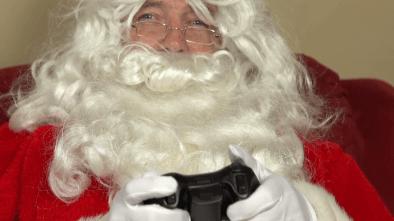 Santa playing video games at Christmas