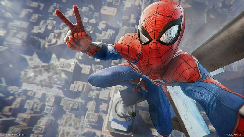 Spider-man taking a selfie on top of a building whilst doing a peace sign