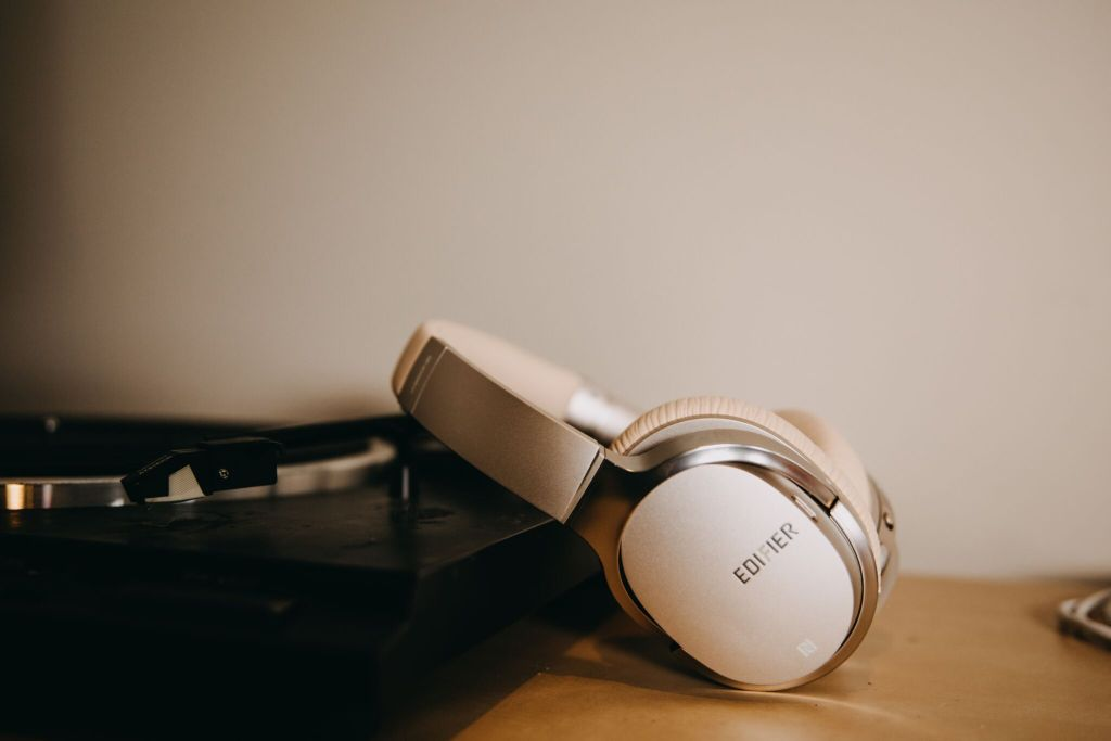 Edifier's W860NB headphones in luxurious golden colour, resting down on a worktop