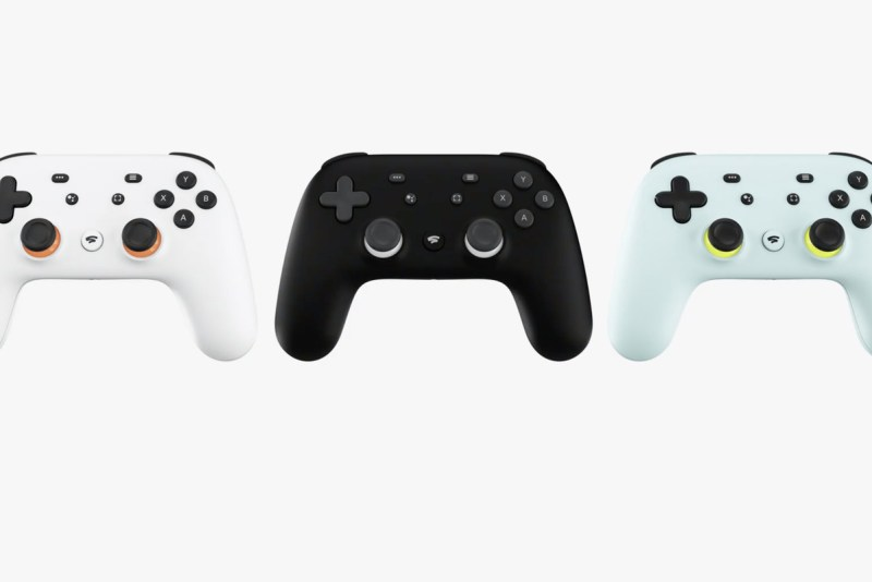 Google Stadia Controller in white, Black and what looks like mint choc chip green