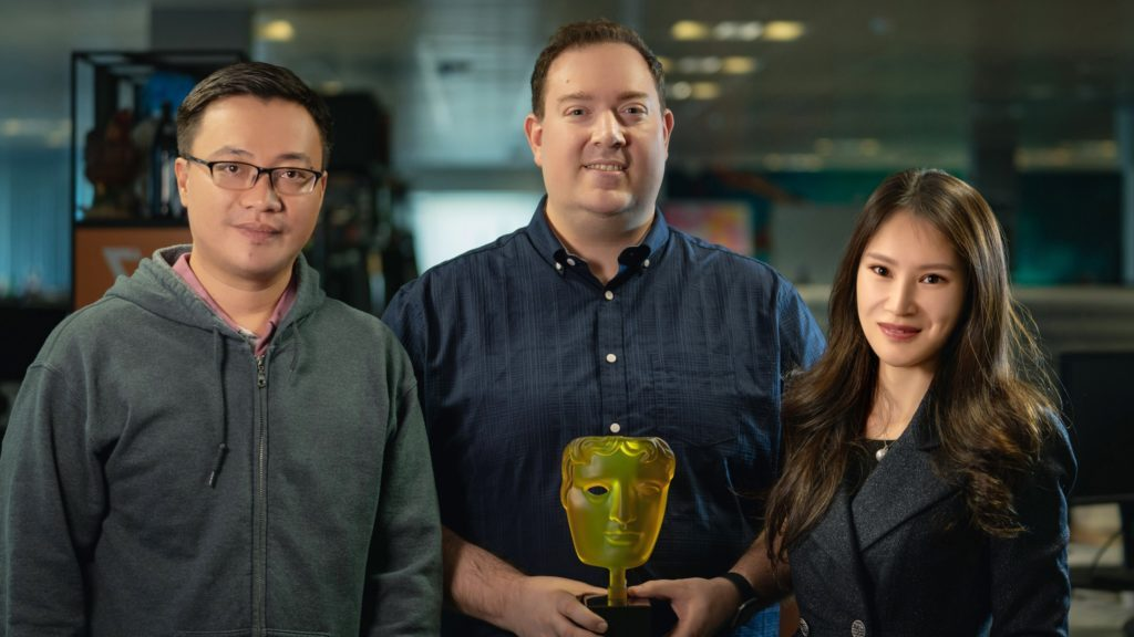 JAGEX's Yuanhui Huang, Phil Mansell and Lisa Pan posing with their BAFTA award