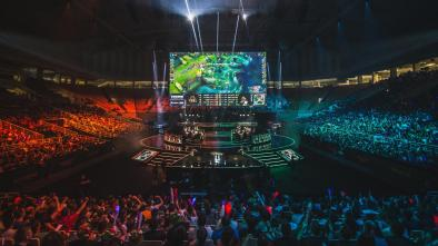 Esports being shown in an arena with a huge packed out crowd
