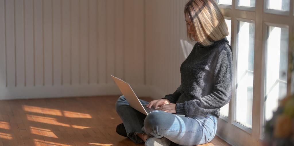 Woman improving her Writing Skills on a laptop