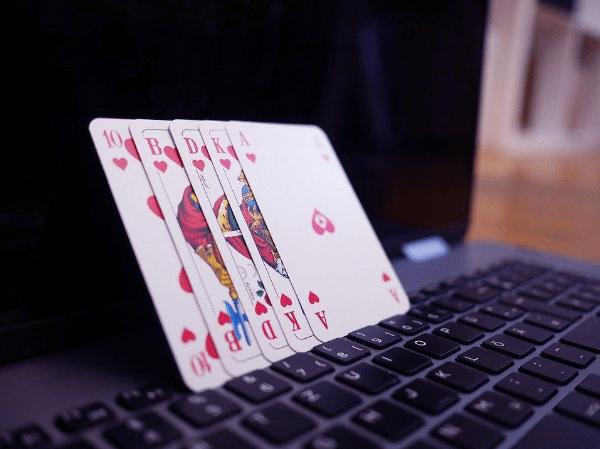 Gambling - Poker - Cards on a laptop showing royal flush
