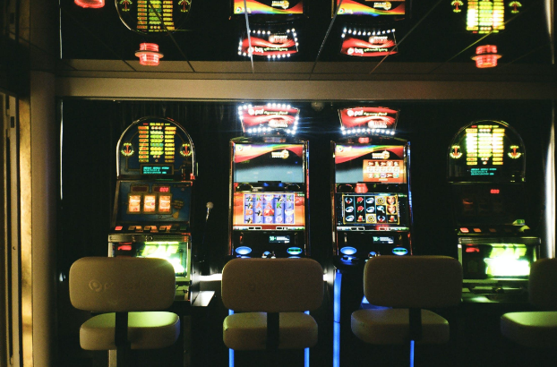 Slot Machines with empty chairs in front