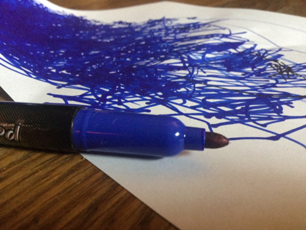 8 Things Parents Never Have Enough Of, blue marker without a lid lying on a piece of paper with blue scribbles