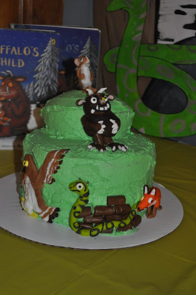 Green birthday cake with the characters from The Gruffalo