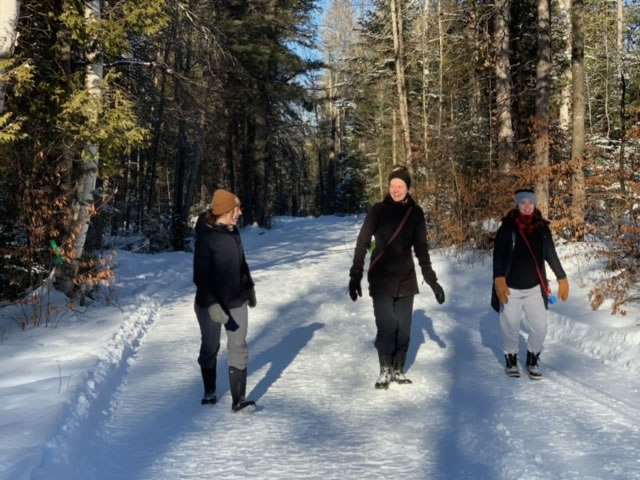 Three women enjoying the walking trails at Fulton's sugarbush near Pakenham