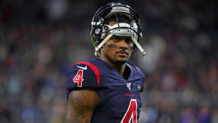Houston Texans quarterback Deshaun Watson (4) waits as officials review a play against the New England Patriots during the second half of an NFL football game Sunday, Dec. 1, 2019, in Houston