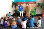Volunteer and member telling the kids stories for Vacation Bible School.