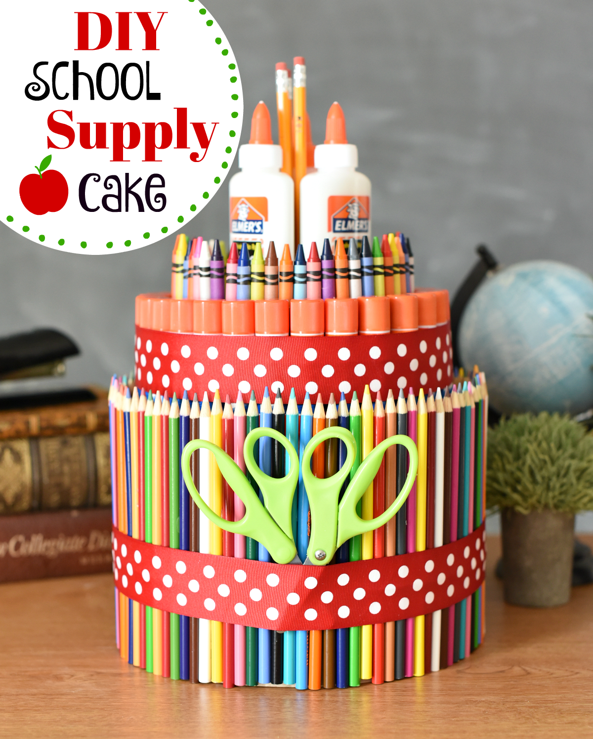 School supply cake! Fun way to start the school year off right. Simple and fun to make, this school supply cake it the perfect back to school gift idea! #schoolsupplies #backtoschool #fungifts