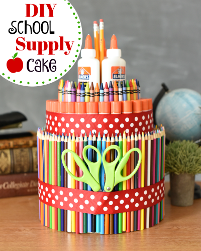 School Supply Cake. Such a fun way to make going back to school fun. So simple to put together, you'll want to make them for everyone. #backtoschool #schoolsupplies #funschoolsupplies #schoolsupplycake
