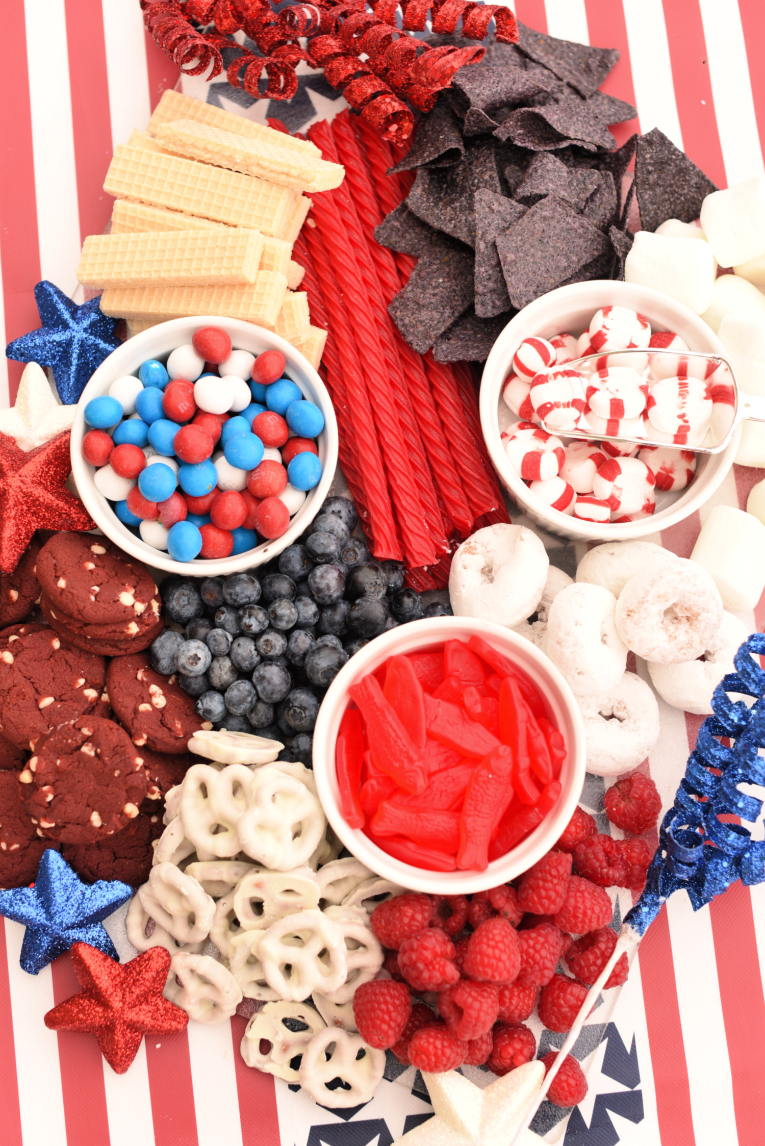Red, White, & Blue Charcuterie Board for the 4th of July or other American holidays! Get patriotic for Independence Day, Memorial Day or any gathering to celebrate America. #4thofJuly #4thofJulyfood #america #independenceday
